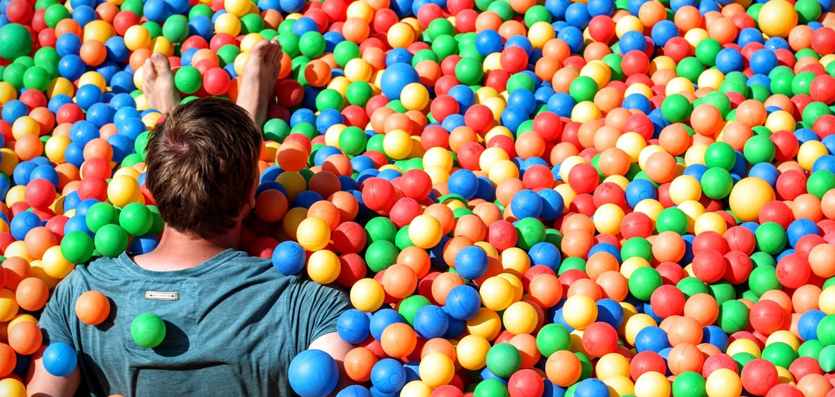 Man swimming in a ball pit