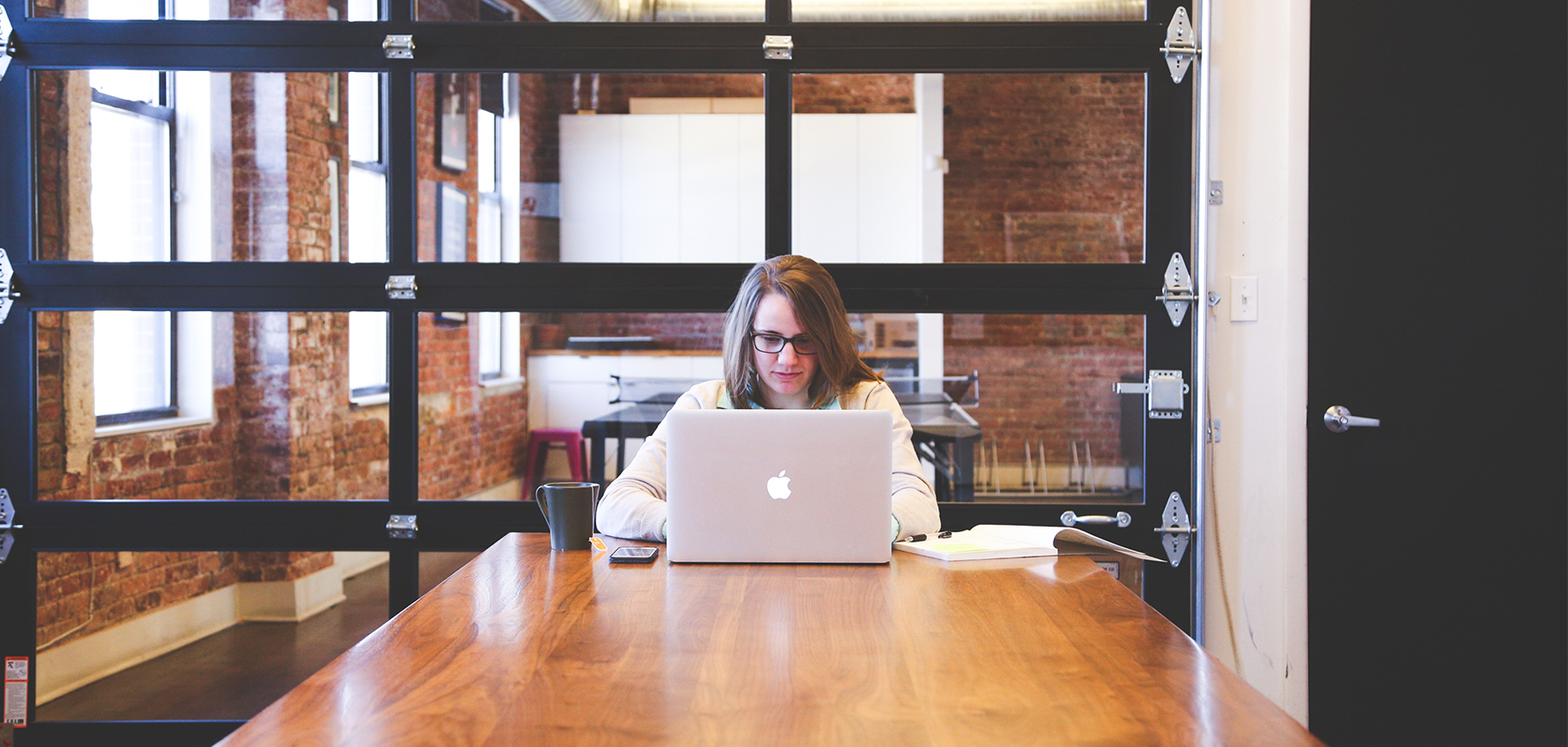 Woman sitting alone in a conference room conducting office space planning