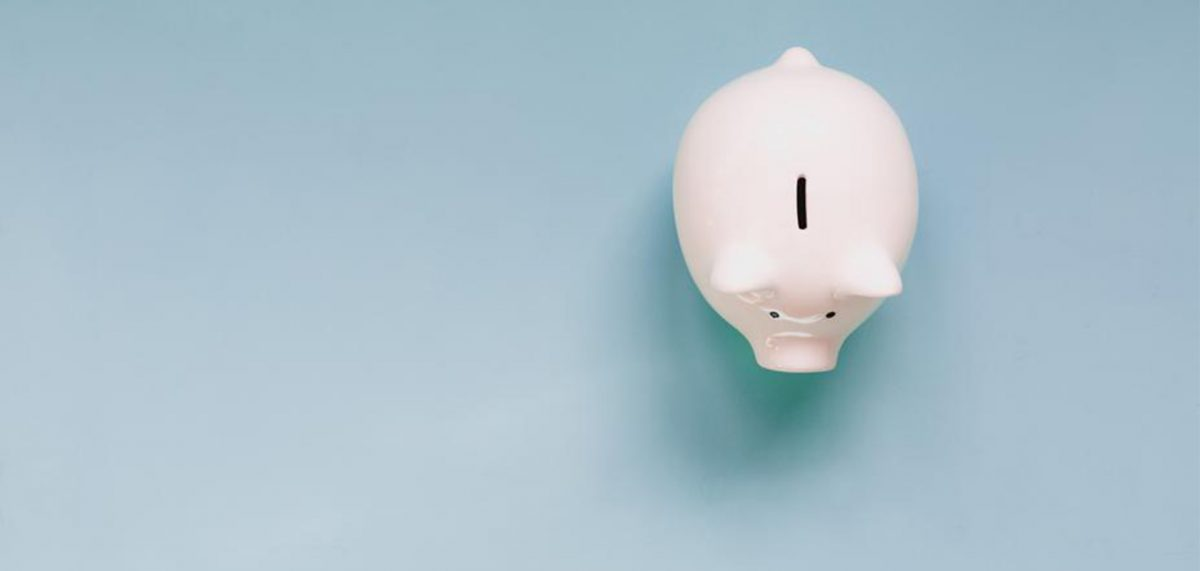 White piggy bank against a blue background