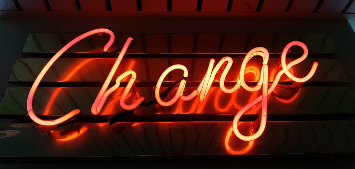 "Orange neon sign saying ""change"""